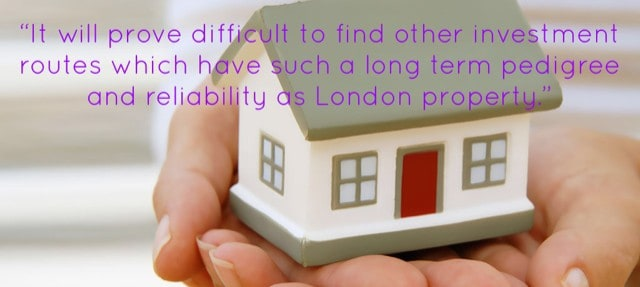 Woman holding miniature house - buy to let landlord investments